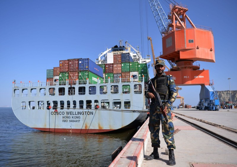Pakistani naval personnel stand guard near a ship at the Gwadar port on Nov. 13, 2016.