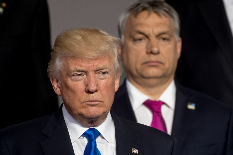 U.S. President Donald Trump stands in front of Hungarian Prime Minister Viktor Orban during a NATO family picture in Brussels on May 25, 2017.