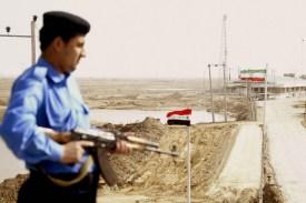 An Iraqi policeman stands guard at a border crossing between Iran and Iraq near the southern Iraqi city of Basra on Feb 26, 2007.