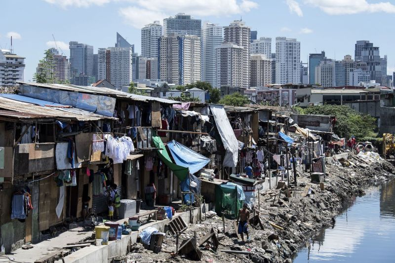 A settlement is seen against the skyline of Manila's financial district in the Philippines on Aug. 17, 2017.
