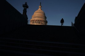 A man walks up the steps in front of the U.S. Capitol in Washington on Jan. 20, 2018.