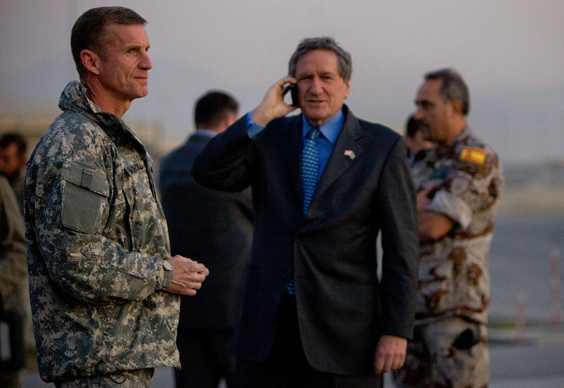 Richard Holbrooke stands next to U.S. General Stanlely McChrystal, head of the U.S. and NATO forces in Afghanistan, before the arrival of Secretary of State Hillary Clinton on Nov. 18, 2009  in Kabul, Afghanistan.