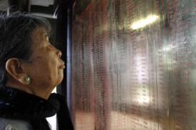 In this picture taken on March 15, 2018, local resident Truong Thi Hong, 76, looks at the names of relatives killed during the My Lai massacre at the war memorial museum in Son My village, Quang Ngai province.