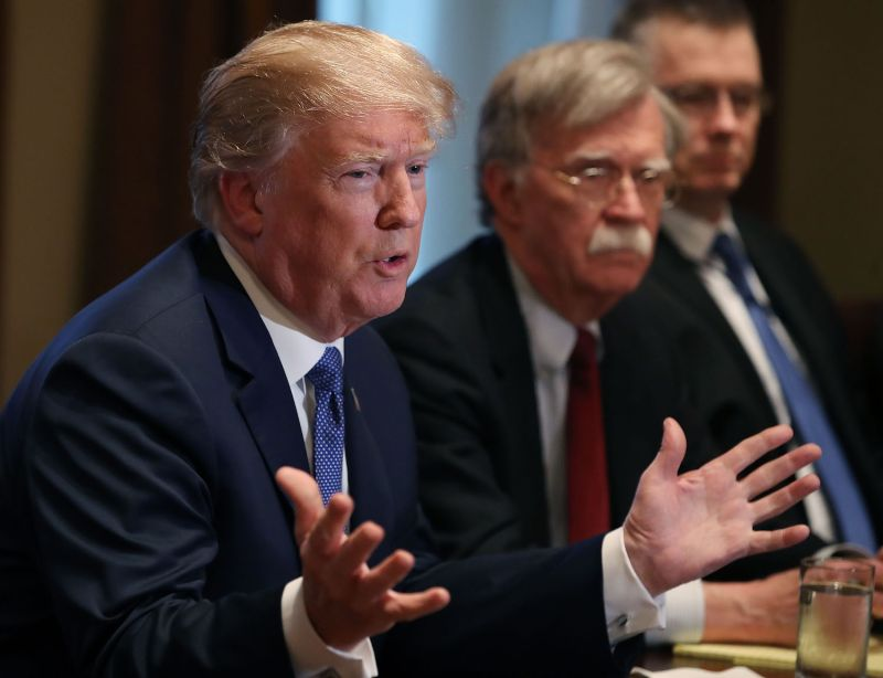 U.S. President Donald Trump is flanked by National Security Advisor John Bolton as he speaks at the White House on April 9, 2018.