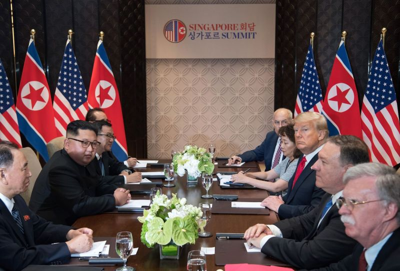 U.S. President Donald Trump and North Korean leader Kim Jong Un sit with their respective delegations for the U.S.-North Korea summit in Singapore on June 12, 2018.