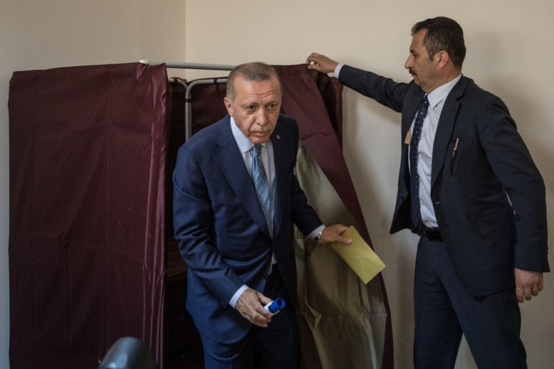 Recep Tayyip Erdogan emerges from the voting booth before casting his vote in the countries parliamentary and presidential election on June 24, 2018 in Istanbul, Turkey.