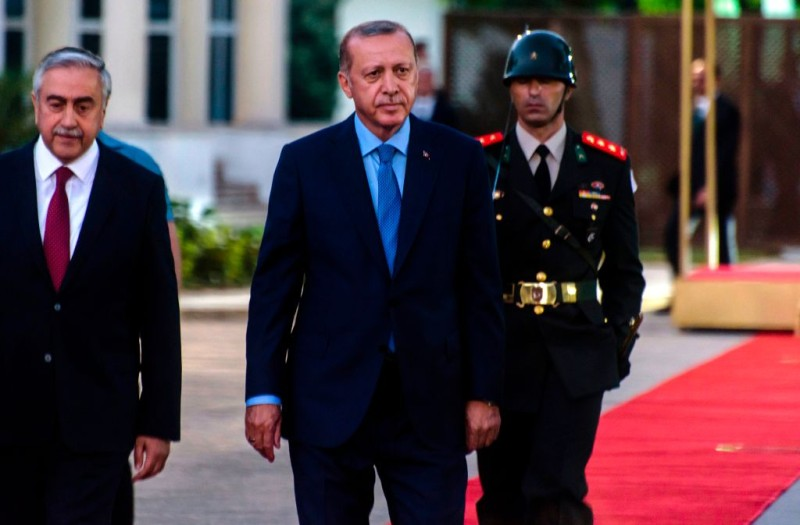 Turkish-Cypriot President Mustafa Akinci walks alongside Turkish President Recep Tayyip Erdogan in the northern part of Nicosia in the self-proclaimed Turkish Republic of Northern Cyprus (TRNC), which is only recognised by Turkey, during a welcome ceremony on July 10, 2018.
