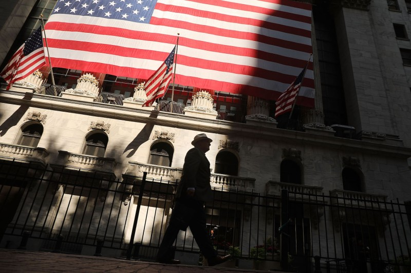 A man walks by the New York Stock Exchange in New York City on July 12, 2018.