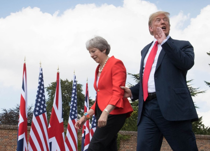 Prime Minister Theresa May and U.S. President Donald Trump make their way to a joint press conference following their meeting at Chequers on July 13, 2018 in Aylesbury, England.