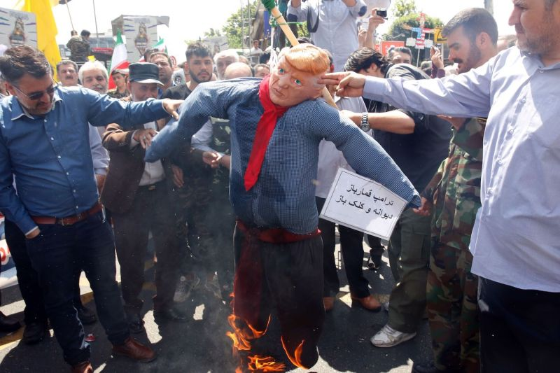 Iranians burn an effigy of U.S. President Donald Trump during a parade on May 31 in Tehran.