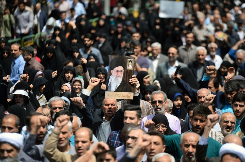 Iranians gather in Tehran during a demonstration to support the goverment's decision to pull out from the nuclear deal on May 10.