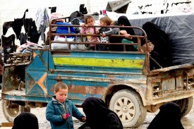 Families are trucked to al Hol on March 10. They came during and after the fall of Baghouz, a farming hamlet that was the final area under Islamic State control. Most had few belongings left.