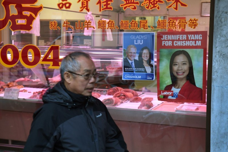 A photograph taken in Melbourne on May 8 shows posters in a butcher's shop for Labor Party candidate Jennifer Yang and Liberal Party candidate Gladys Liu who competed in the May 18 election for the outer Melbourne electorate of Chisholm, where one in five households speak either Mandarin or Cantonese.