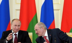 Russian President Vladimir Putin (left) and his Belarusian counterpart, Alexander Lukashenko, attend a joint press conference in St. Petersburg, Russia, on March 15, 2013.
