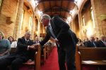 Australian Prime Minister Scott Morrison (C) shakes hands with Opposition Leader Bill Shorten (L) at a special ecumenical service to mark the start of the parliamentary year at St Paul's Anglican church on Feb. 12 in Canberra, Australia.