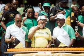 South African President Cyril Ramaphosa (R) toasts with former President Jacob Zuma (C) and African National Congress (ANC) Secretary-General Ace Magashule (L) during the ANC's 107th anniversary celebrations in Durban on Jan. 12.