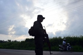 A Sri Lankan security officer stands guard at a roadside checkpoint in Minuwangoda on May 14.
