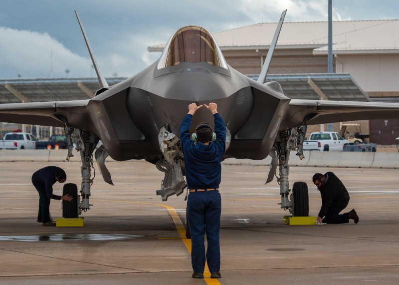 A Lockheed Martin crew chief signals to the F-35A Lightning II pilot that chocks have been placed, Feb. 4, 2019 at Luke Air Force Base, Ariz. (U.S. Air Force photo by Airman 1st Class Aspen Reid)