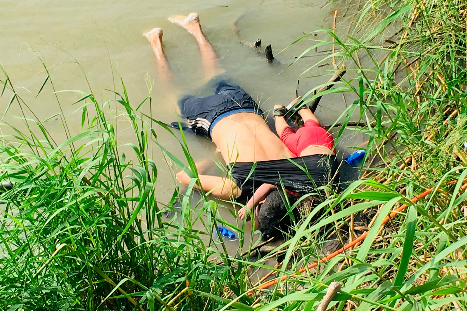 The bodies of Salvadoran migrant Oscar Alberto Martínez Ramírez and his nearly 2-year-old daughter Valeria rest on the bank of the Rio Grande in Matamoros, Mexico, on June 24, after they drowned trying to cross the river to Brownsville, Texas. Julia Le Duc/La Jornada/AP