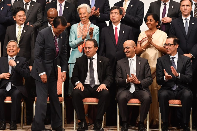 IMF Managing Director Christine Lagarde welcomes Japanese Finance Minister Taro Aso, U.S. Treasury Secretary Steven Mnuchin, and others at the G-20 finance ministers and central bank governors meeting in Fukuoka, Japan, on June 9.