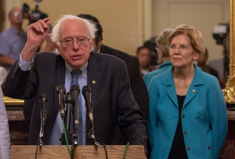 Bernie Sanders and Elizabeth Warren attend a news conference in Washington on July 24, 2018.