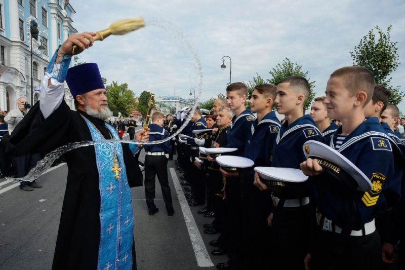 "An Orthodox priest and cadets of the Nakhimov naval academy take part in the opening ceremony for the start of a new academic year known as the ""Day of Knowledge"" in Saint-Petersburg, on September 1, 2018."