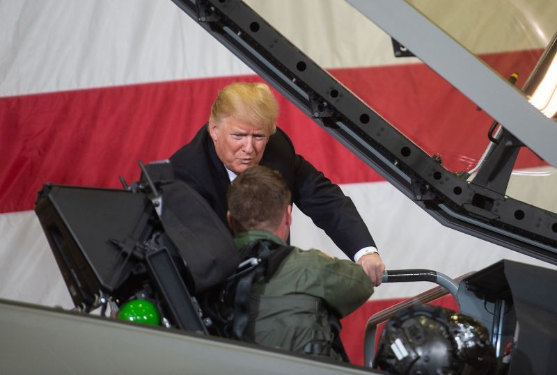 U.S. President Donald Trump speaks with F-35 fighter plane pilot Lt. Col. Jason Curtis as he tours Luke Air Force Base in Phoenix on Oct. 19, 2018.