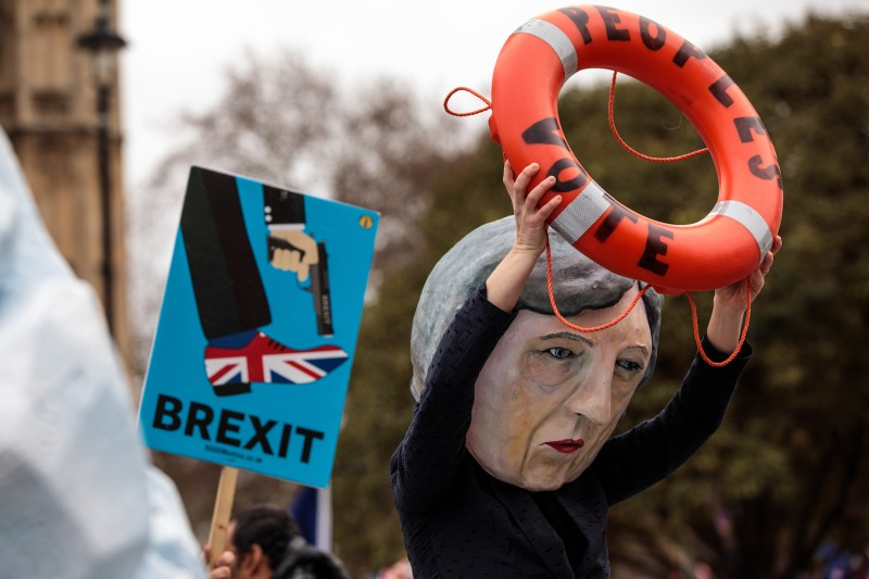A papier-mâché Theresa May is seen during a demonstration outside the Houses of Parliament in London on Jan. 15.