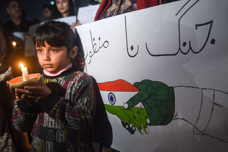 A Pakistani girl holds a candle during a vigil for peace in Lahore on March 3.