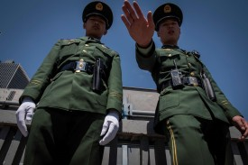 Two paramilitary police officers secure an area along a street during the Belt and Road Forum in Beijing on April 25, 2019.