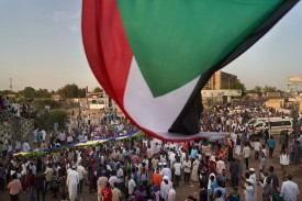 A flag is waved over protests in Khartoum, Sudan, on May 3.