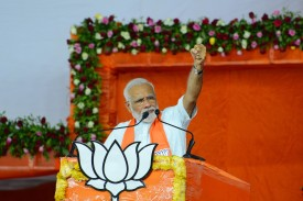 Indian Prime Minister Narendra Modi gestures during a rally in Ahmedabad on May 26, 2019.