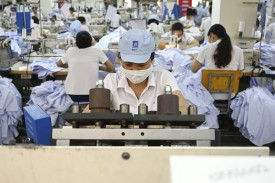 This photograph taken on May 24, 2019 shows garment factory stitching apparel in a factory in Hanoi.