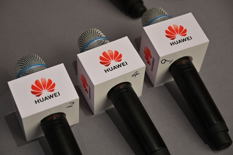 Microphones with the Huawei logo are seen at a press conference at the Huawei facilities in Shenzhen, Guangdong province on May 29, 2019