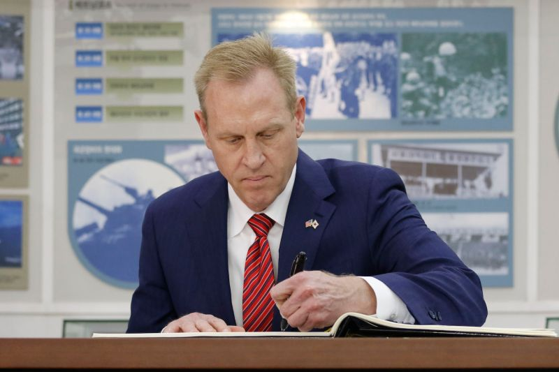 U.S. Defense Secretary Patrick Shanahan writes in a guest book before a ministerial talk in Seoul. SEUNG-IL RYU/NURPHOTO VIA GETTY IMAGES