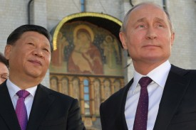 Russian President Vladimir Putin and his Chinese counterpart, Xi Jinping, tour the Kremlin in Moscow on June 5.