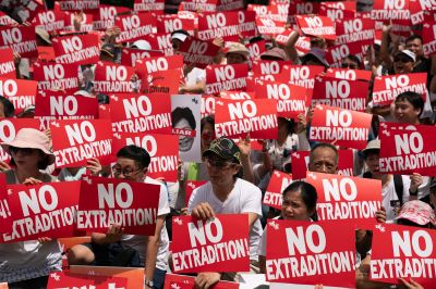 Protesters hold placards and shout slogans during a rally against the extradition law proposal in Hong Kong on June 9.