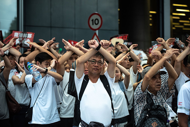 "Protesters chant, ""No extradition,"" as they rally against the controversial extradition law proposal in Hong Kong on June 9."