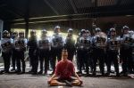 Police gather at a rally against a controversial extradition law proposal in Hong Kong on early June 10, 2019.