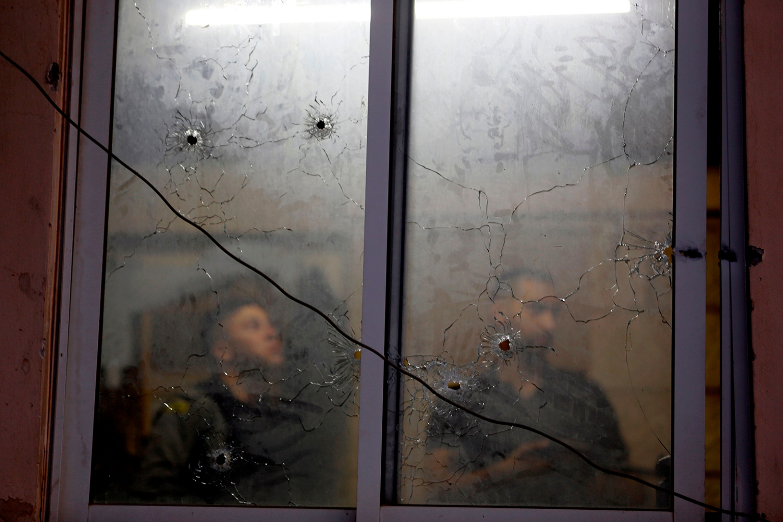 Bullet holes scar the Palestinian Authority security apparatus headquarters in Nablus, in the occupied West Bank, on June 11 after Israeli troops exchanged fire with Palestinian security forces in a rare shootout that Israel's army said was the result of mistaken identity. JAAFAR ASHTIYEH/AFP/Getty Images
