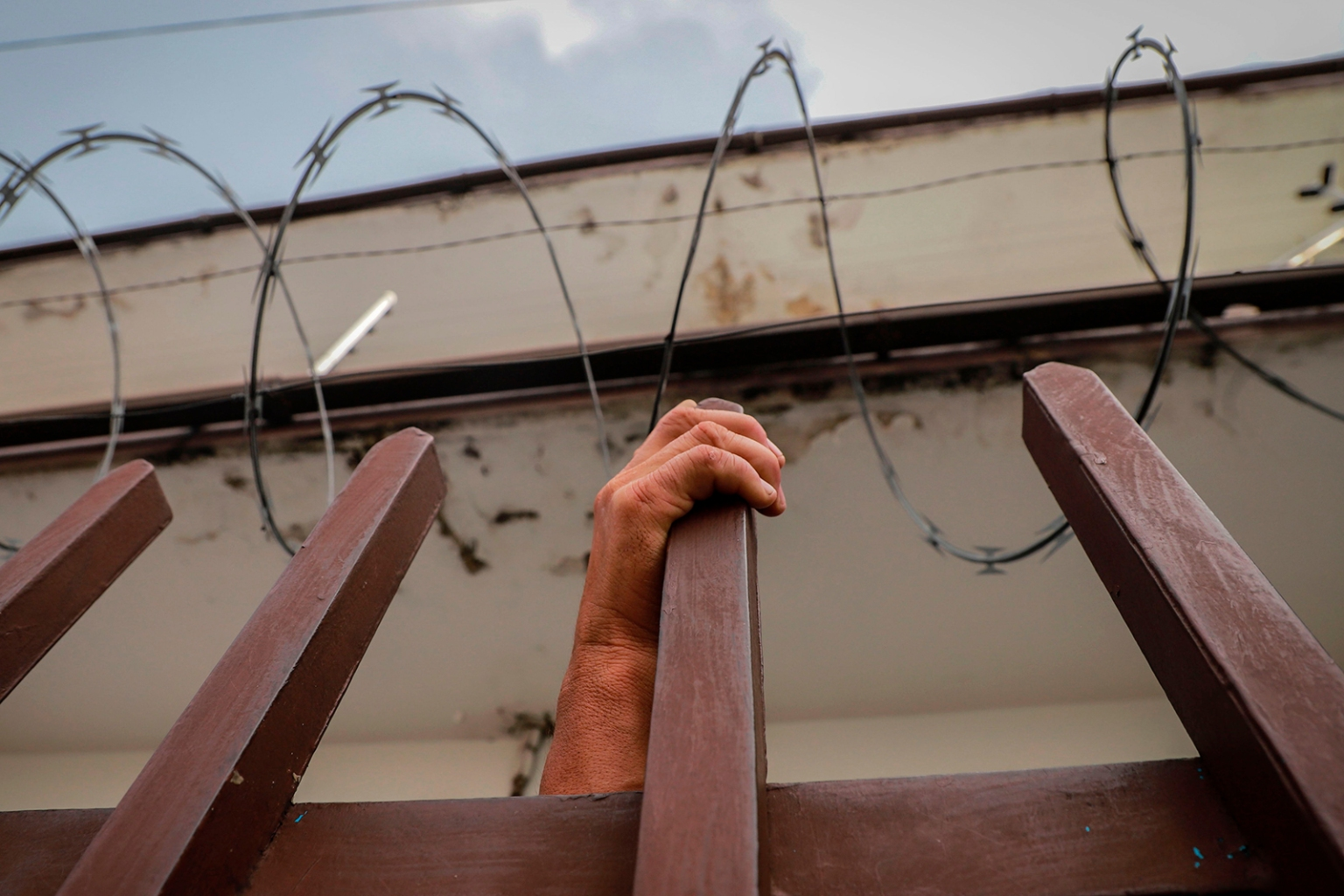 A Central American migrant waits to be assisted at the Mexican Commission for Refugee Aid  in Tapachula, Mexico, on June 11. QUETZALLI BLANCO/AFP/Getty Images