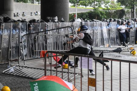 Protesters clash with police during a demonstration outside the Legislative Council Complex in Hong Kong on June 12. ANTHONY WALLACE/AFP/Getty Images