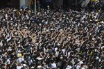 Protesters shout out after police fired tear gas during a rally against a controversial extradition law proposal in Hong Kong on June 12, 2019.