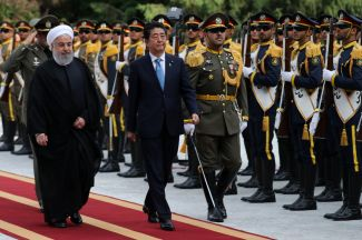 Iranian President Hassan Rouhani, left, welcomes Japanese Prime Minister Shinzo Abe at the Saadabad Palace in Tehran on June 12.