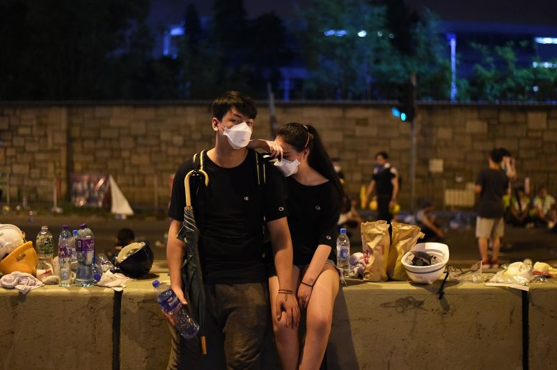 Demonstrators take a rest the night after a protest against a controversial extradition law proposal in Hong Kong on June 12, 2019.
