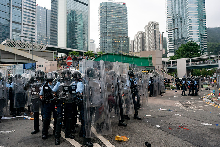 Police officers charge toward protesters during a demonstration on June 12 in Hong Kong.