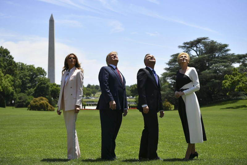 US President Donald Trump, First Lady Melania Trump, Poland's President Andrzej Duda and his wife Agata Kornhauser-Duda watch as an F-35 fighter planes flies over the White House on June 12, 2019, in Washington DC. (Photo by MANDEL NGAN / AFP)        (Photo credit should read MANDEL NGAN/AFP/Getty Images)