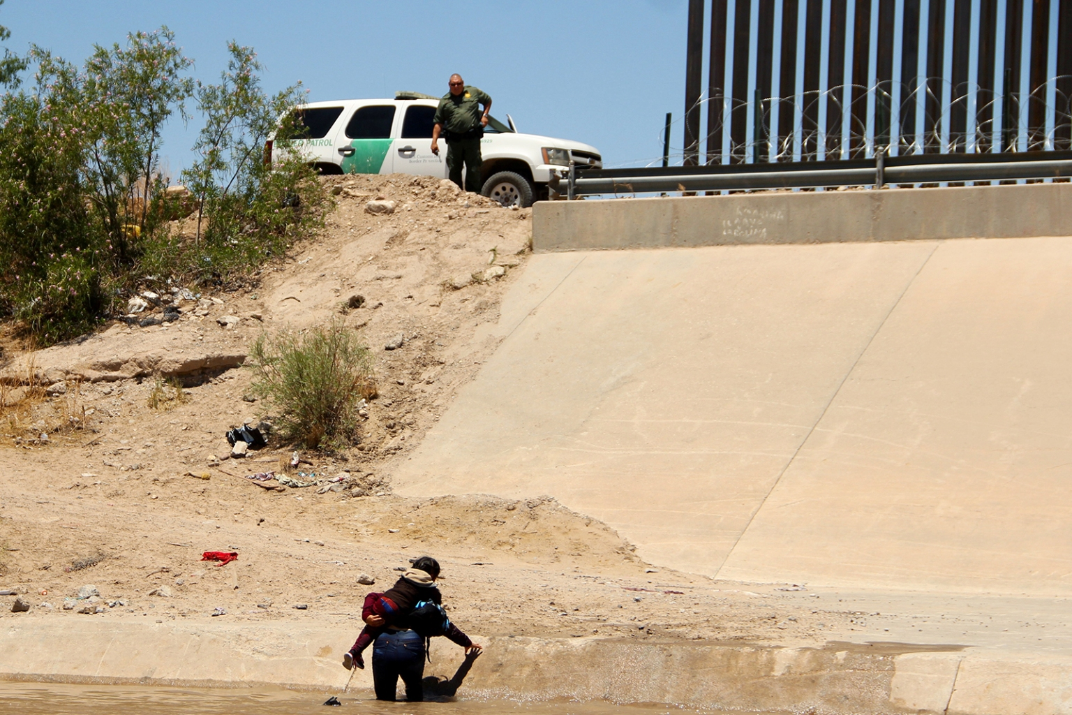 A Central American migrant carries a girl across the Rio Grande in Ciudad Juarez, Mexico, on June 12, before turning themselves into U.S. Border Patrol agents to claim asylum. HERIKA MARTINEZ/AFP/Getty Images