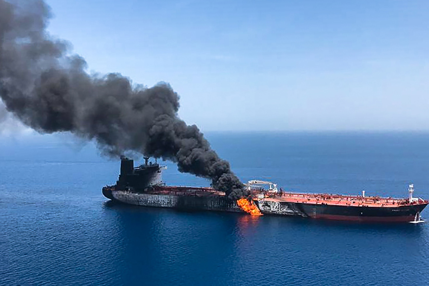 Fire and smoke billows from the Norwegian-owned Front Altair oil tanker said to have been attacked in the waters of the Gulf of Oman in this picture from the Iranian News Agency ISNA on June 13. -/AFP/Getty Images