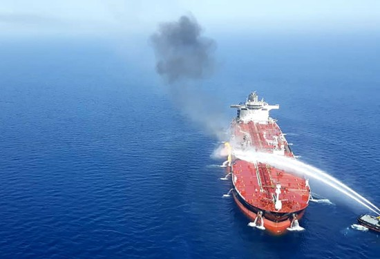 A from Iranian news agency Tasnim reportedly shows an Iranian navy boat trying to control the fire from the Norwegian-owned Front Altair tanker in the Gulf of Oman on June 13.